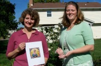 Lisa Everett, left, co-director of the Office of Family Life, holds a picture of St. Hannah, patron saint of childless wives. Suzy Younger, who works with Hannah's Tears, an organization that offers prayers and support for those suffering from infertility, holds a rosary.