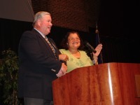 In a gesture of solidarity from the Civil Rights Movement Dr. Alveda King clasps arms with the St. Joseph County Right to Life dinner master of ceremonies Bob Nagle, and she leads attendees in song.