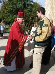Judy Bradford Bishop D'Arcy shakes hands with Michael Agrippina, a high school junior from Atlanta, who was visiting the University of Notre Dame and attended the Red Mass for law students, attorneys and political officials.