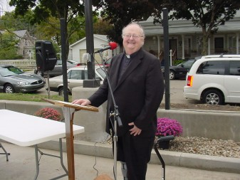 Father William Kummer, pastor of St. Michael Church, Plymouth, is delighted with the new playground dedicated on St. Michael's feast day, Sept. 29.