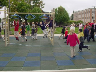 The school children of St. Michael, Plymouth, celebrate the opening of their new playground on N. Michigan St.The dedication and opening ceremonies were on Sept. 29, St. Michael's feast day.