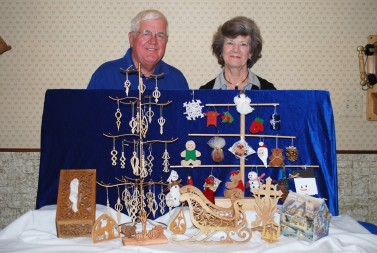Kathy and Bob Kania exhibit some of the ornaments that are displayed on the Queen of Peace Parish Christmas tree.