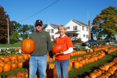 Ed and Linda Leininger, of Leininger Farms, stand in their pumpkin patch.