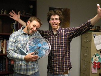 """Kyle Heimann, left, a native of Decatur, who grew up at St. Mary of the Assumption Parish and attended St. Joseph School there, """"clowns around"""" with Dan Harms, who now lives in Decatur. The two make up the acoustic-rock and Catholic ministry team of Popple. Their fifth album, """"Hip Hip Hooray"""" has recently been released."""