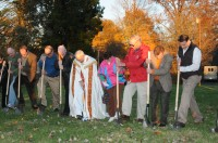 Among participants breaking ground for the new St. Clement Church in Boonville are Ron, Tubbs, Dan Harpenau, Richard Lasher, Kevin Callahan, Father Lowell Will, Bob and Ann Martin, Bernard Peter and Joe Derr; also participating but not in the range of the photograph were Boonville Mayor Pam Hendrickson and Julie Malone. (Message photo by Paul R. Leingang)