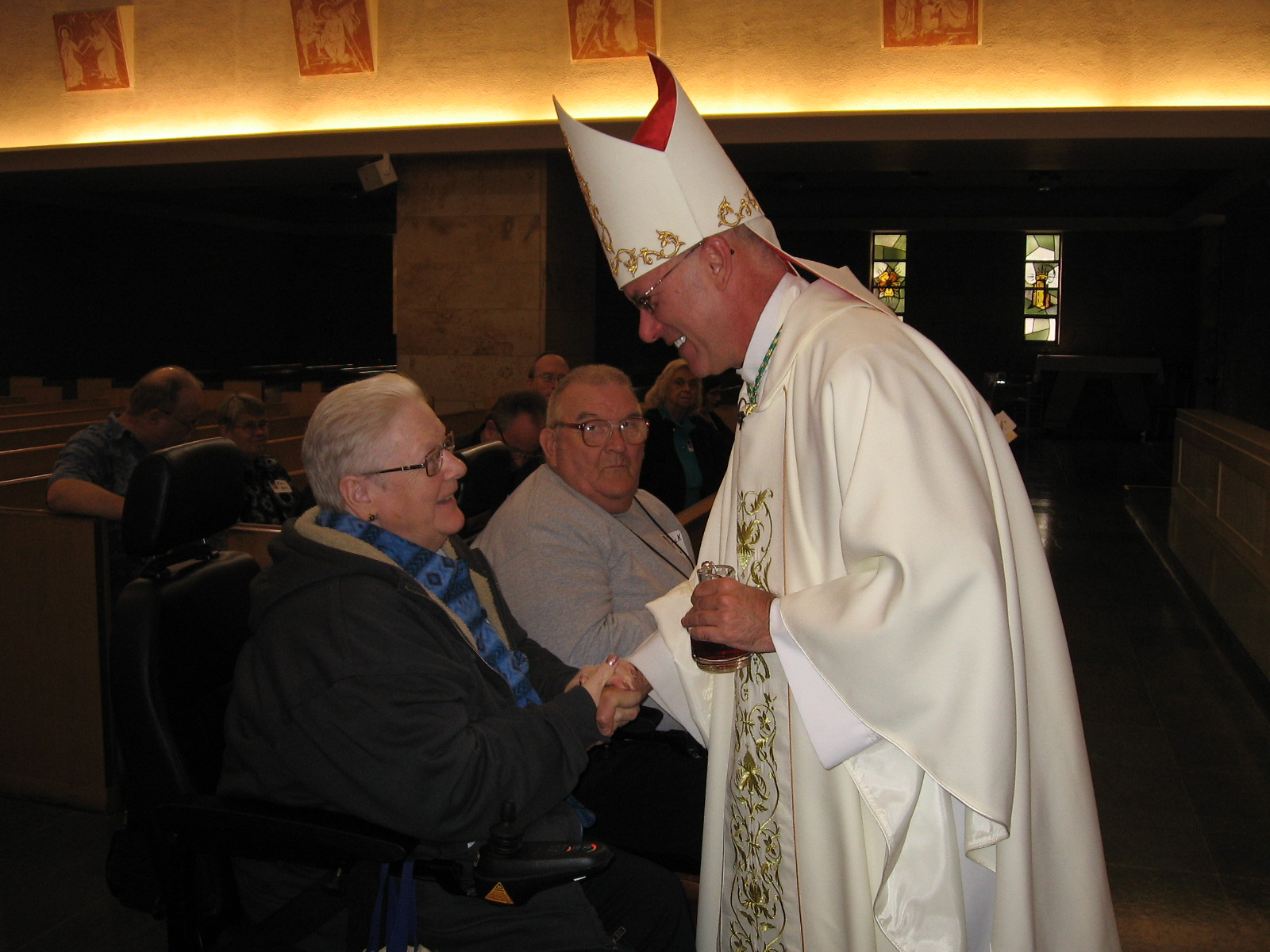 Retreat for disabled offers renewal and hope todays catholic offertory gift bearers pinkie and dick louden greet bishop kevin c rhoades from wheelchairs at a mass that began the sixth annual disabilities retreat at m4hsunfo