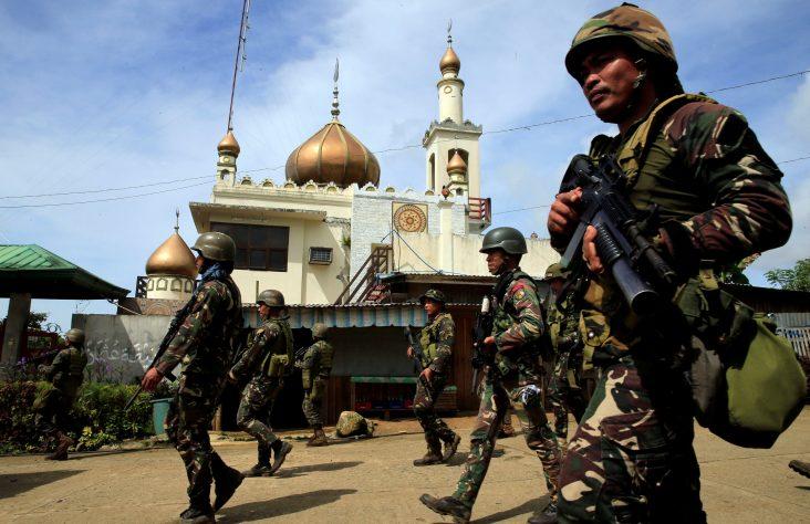Gunmen take Catholic hostages; Philippines' Duterte imposes martial law