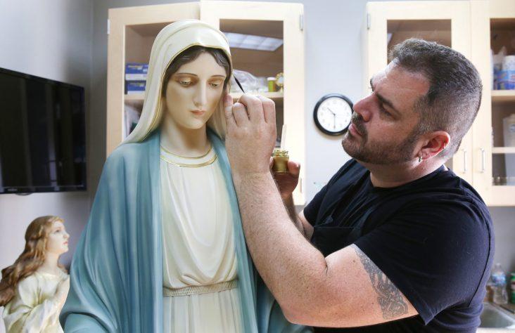 Ohio artist restores religious statues, stirs memories of closed parishes