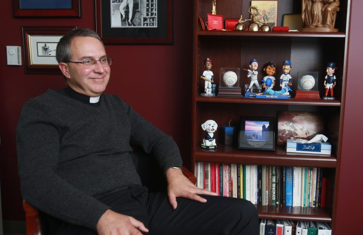 Brewers chaplain finds joy in connecting his love of priesthood, sports