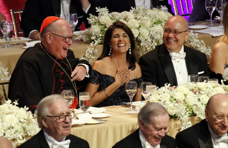 Smith dinner's tone lighthearted, but abuse crisis not ignored in remarks