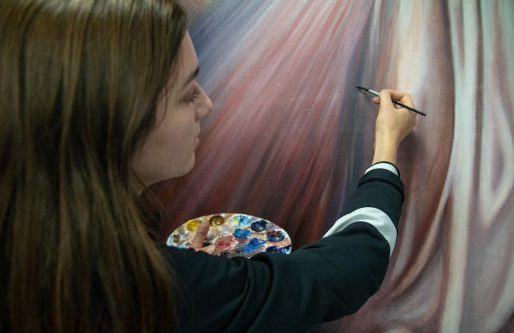 Marian students paint Divine Mercy image