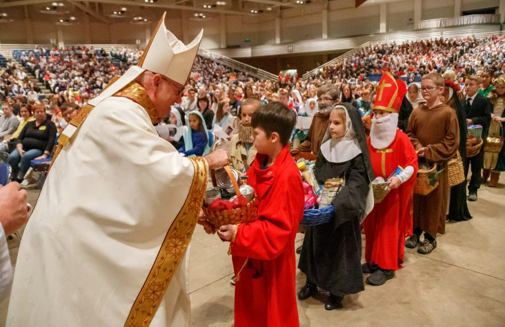 Students urged to be like saints, 'fruitful branches on the vine'