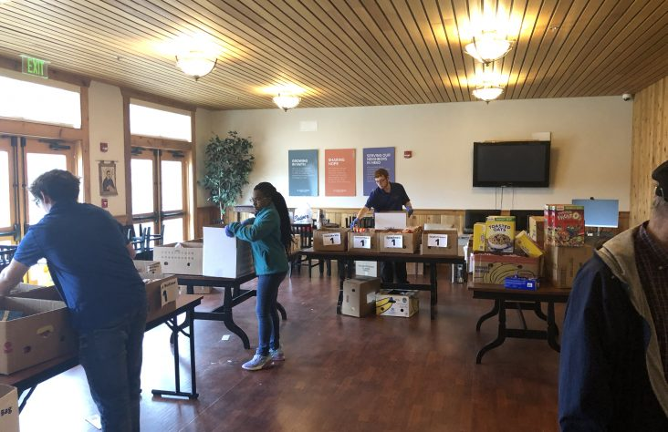 St. Vincent de Paul volunteers rush to create food boxes
