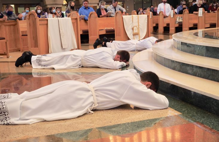 Priest, deacons ordained to mission of service