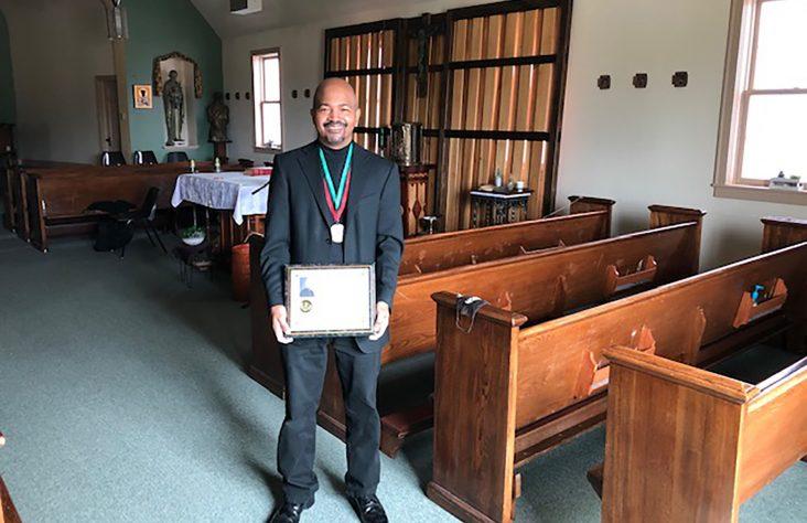 Deacon Tardy receives Black role models award